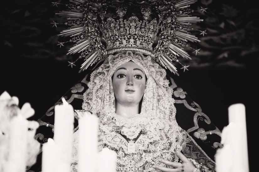 photo of mother mary with candles